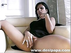 Indian babe suravinda masturbating in her lounge fingering her shaved pussy